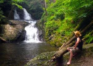 seamus mcgraw sitting at creek in poconos